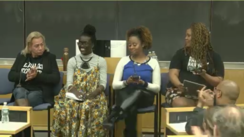 Wakumi and four other women sitting in chairs presenting